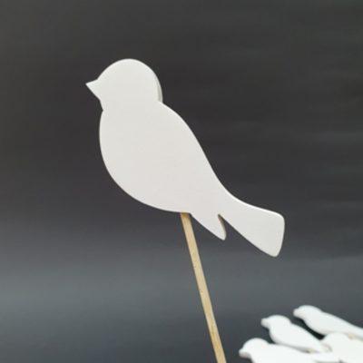 Biały ptak na piku