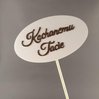 Tabliczka na piku z napisem: Kochanemu Tacie