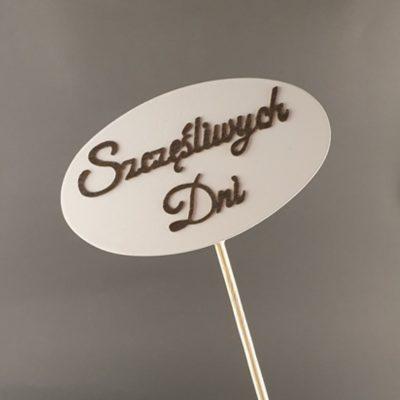 Tabliczka na piku z napisem: Szczęśliwych dni