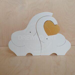 Białe słonie ze złotym sercem